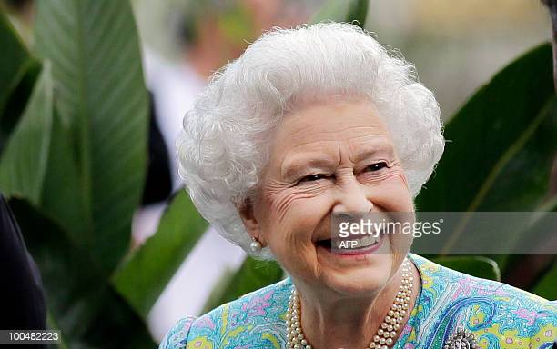 Britain's Queen Elizabeth II smiles as she visits gardens at the Chelsea Flower Show in London, on May 24, 2010. The show, which has 600 exhibitors,...