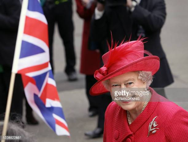 Britain's Queen Elizabeth II smiles as she walks along Windsor High Street in Windsor as part of her 80th Birthday celebrations, 21 April 2006. The...