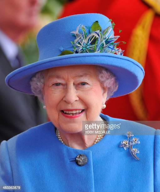 Britain's Queen Elizabeth II smiles as she welcomes Irish President Michael D Higgins during the Ceremonial Welcome outside Windsor Castle in Windsor...