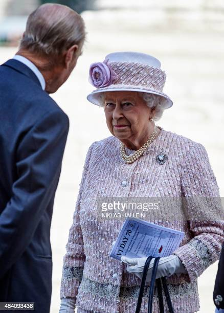 Britain's Queen Elizabeth II smiles at Britain's Prince Phillip Duke of Edinburgh as they leave a Service of Commemoration at St MartinintheFields...