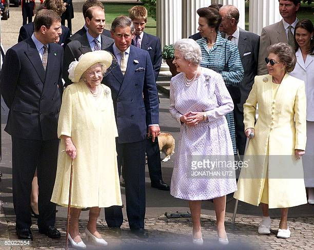 Britain's Queen Elizabeth II smiles at Queen Mother with other members of the royal family on the occasion of the Queen Mother's 99th birthday at her...