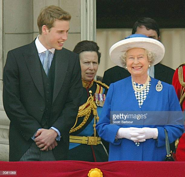 Britain's Queen Elizabeth II smiles at the crowd from the balcony of Buckingham Palace as Prince William and Princess Anne look on after attending...