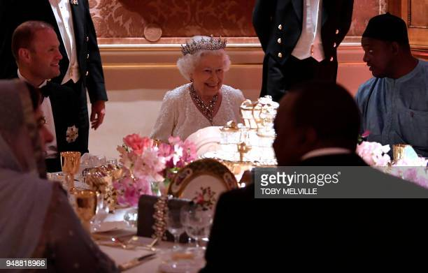 Britain's Queen Elizabeth II smiles in the Picture Gallery at The Queen's Dinner during The Commonwealth Heads of Government Meeting at Buckingham...