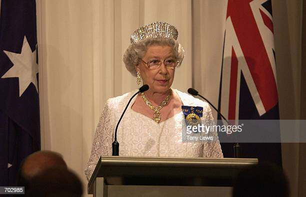 Britains Queen Elizabeth II speaks at a dinner hosted by the Prime Minister of Australia John Howard on the first day of her visit February 27 2002...
