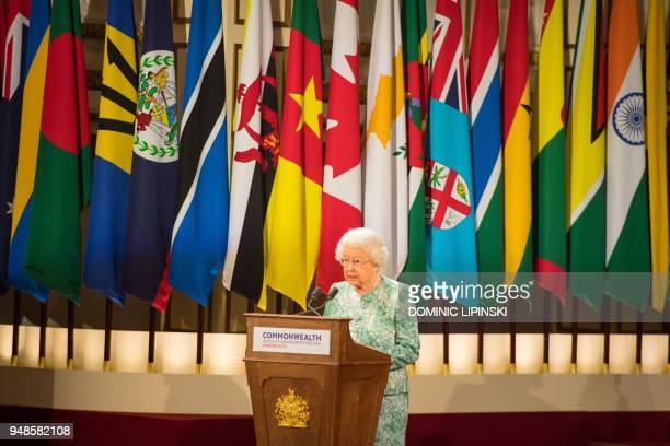 TOPSHOT Britain's Queen Elizabeth II speaks at the formal opening of the Commonwealth Heads of Government Meeting at Buckingham Palace in London on...