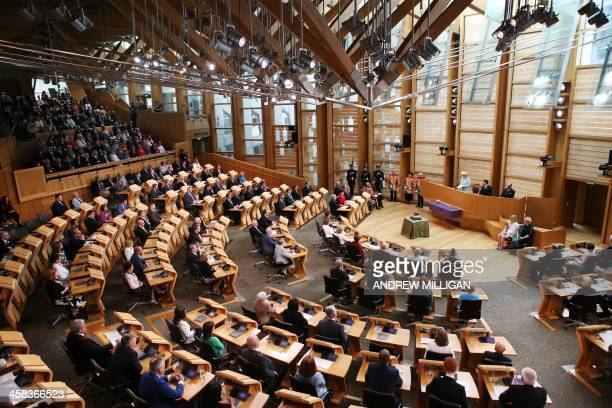 Britain's Queen Elizabeth II speaks during the opening of the fifth session of the Scottish Parliament in Edinburgh Scotland on July 2 2016 / AFP /...