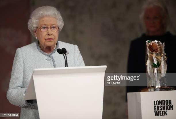 Britain's Queen Elizabeth II speaks prior to presenting the inaugural Queen Elizabeth II Award for British Design to British fashion designer Richard...