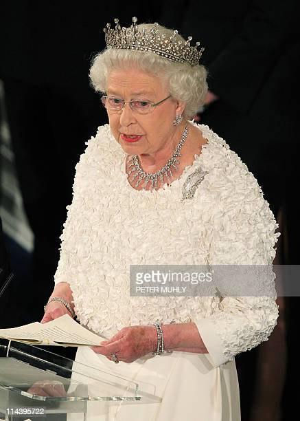 Britain's Queen Elizabeth II speaks to guest at a state dinner in Saint Patrick's Hall at Dublin Castle in Dublin on May 18, 2011. Queen Elizabeth II...