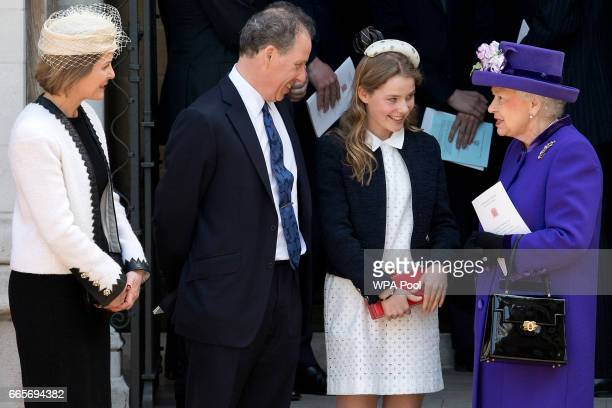Britain's Queen Elizabeth II speaks to Serena ArmstrongJones David ArmstrongJones and Margarita ArmstrongJones as they leave a Service of...