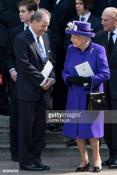 Britain's Queen Elizabeth II speaks with David ArmstrongJones 2nd Earl of Snowdon known as David Linley as Britain's Prince Philip Duke of Edinburgh...