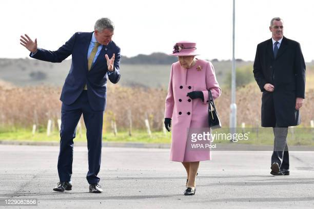 Britain's Queen Elizabeth II speaks with Dstl Chief Executive Gary Aitkenhead as she arrives at the Energetics Analysis Centre as they visit the...