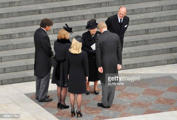 Britain's Queen Elizabeth II speaks with Mark Thatcher , as his wife Sarah , his sister Carol, Carol's partner Marco Grass and Prince Philip, Duke of...