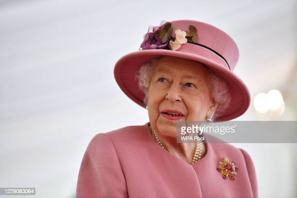 Britain's Queen Elizabeth II speaks with staff during a visit to the Defence Science and Technology Laboratory at Porton Down science park on October...