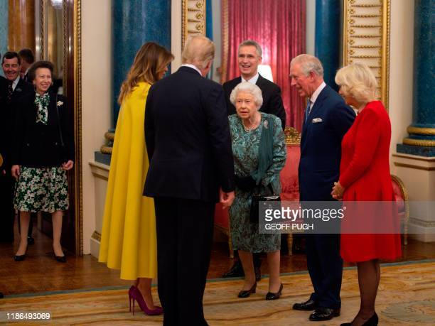 TOPSHOT Britain's Queen Elizabeth II speaks with US First Lady Melania Trump and US President Donald Trump in Buckingham Palace in central London on...
