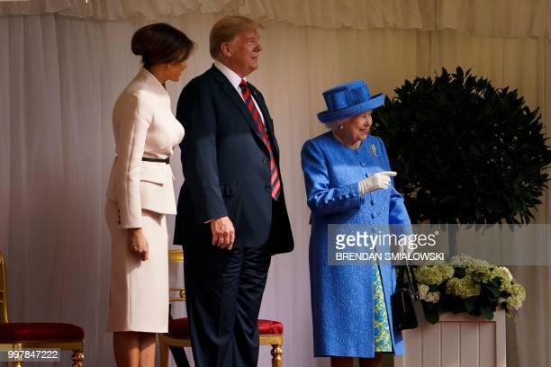 Britain's Queen Elizabeth II speaks with US President Donald Trump and US First Lady Melania Trump at Windsor Castle in Windsor west of London on...