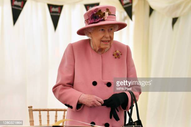 Britain's Queen Elizabeth II stands after signing a visitor's book during her visit to the Defence Science and Technology Laboratory at Porton Down...
