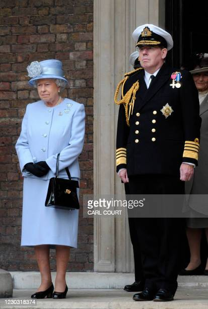 Britain's Queen Elizabeth II stands beside First Sea Lord, Admiral Sir Mark Stanhope during a visit to the Admiralty Board and Admiralty House with...