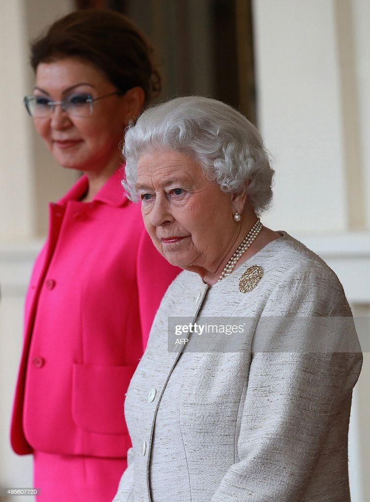 Britain's Queen Elizabeth II (R) stands next to Kazakhstan's Deputy Prime Minister Dariga Nazarbayeva at Buckingham Palace in London on November 4, 2015. Britain and Kazakhstan signed trade deals worth 3 billion GBP (4.2 billion euros, 4.6 billion USD) on November 3 as London rolled out the red carpet for the country's autocratic President Nursultan Nazarbayev.