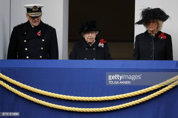 TOPSHOT Britain's Queen Elizabeth II stands on the balcony with Britain's Prince Philip Duke of Edinburgh and Britain's Camilla Duchess of Cornwall...