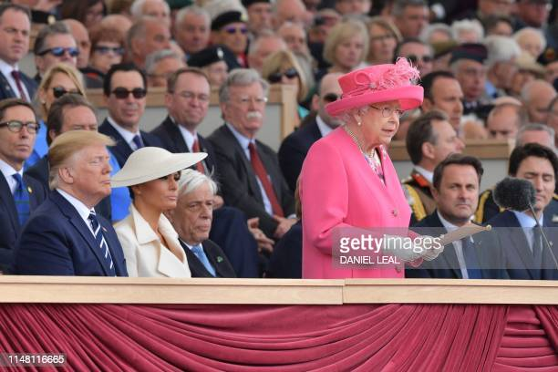 Britain's Queen Elizabeth II stands to make her address during an event to commemorate the 75th anniversary of the DDay landings in Portsmouth...