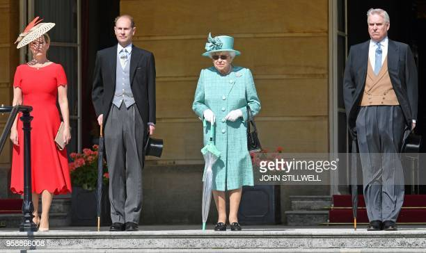 Britain's Queen Elizabeth II stands with her sons Britain's Prince Andrew Duke of York and Britain's Prince Edward Earl of Wessex and his wife...