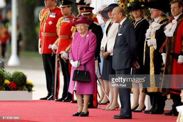 Britain's Queen Elizabeth II stands with Prince Philip Duke of Edinburgh as they wait to greet Spain's King Felipe and his wife Queen Letizia during...