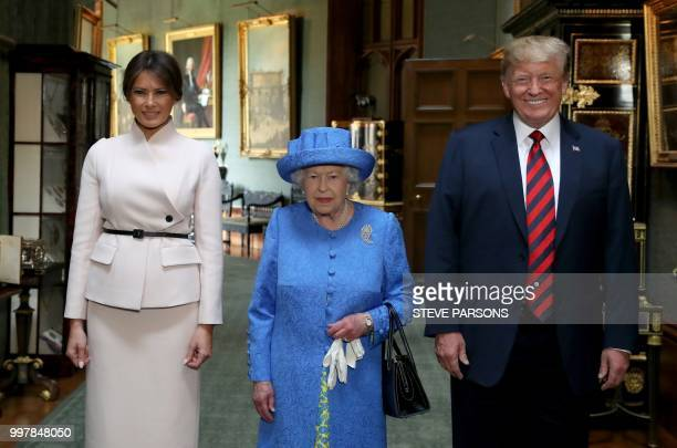 Britain's Queen Elizabeth II stands with US President Donald Trump and US First Lady Melania Trump in the Grand Corridor at Windsor Castle in Windsor...