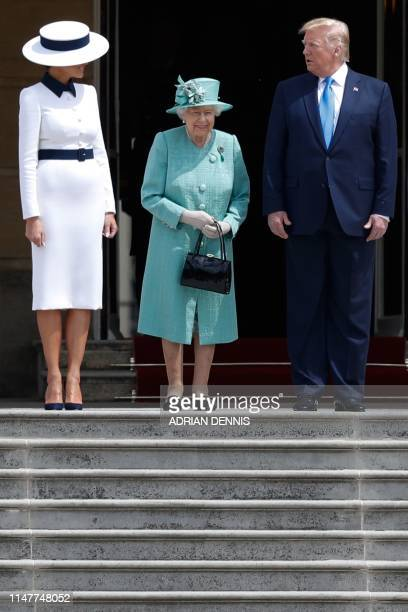 Britain's Queen Elizabeth II stands with US President Donald Trump as US First Lady Melania Trump during a welcome ceremony at Buckingham Palace in...