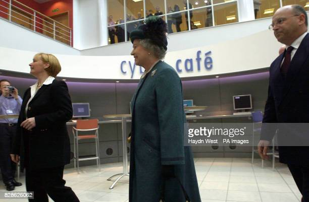 Britain's Queen Elizabeth II surveys the staff Cyber Cafe at the Halifax Bank of Scotland call centre at Cromac Wood in south Belfast On the final...
