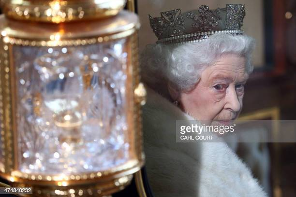 Britain's Queen Elizabeth II takes her seat in the Diamond Jubilee State Carriage to leave the Palace of Westminster in central London on May 27 2015...