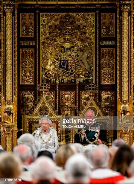Britain's Queen Elizabeth II takes her seat on the The Sovereign's Throne in the House of Lords next to Britain's Prince Charles Prince of Wales...