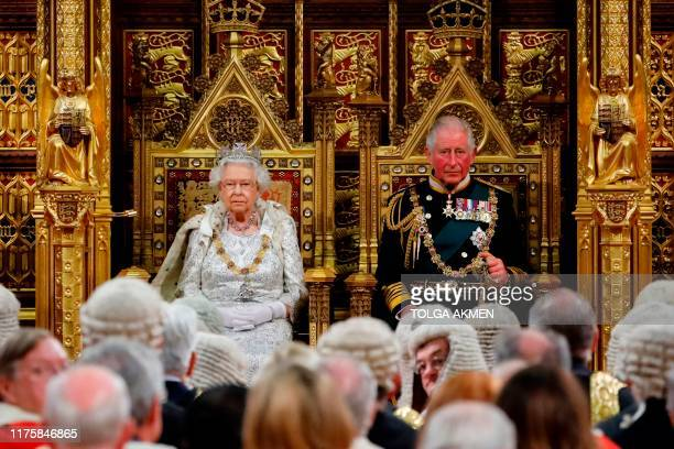 TOPSHOT Britain's Queen Elizabeth II takes her seat on the The Sovereign's Throne in the House of Lords next to Britain's Prince Charles Prince of...