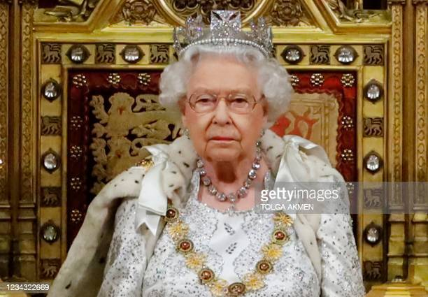 Britain's Queen Elizabeth II takes her seat on the The Sovereign's Throne in the House of Lords next to Britain's Prince Charles, Prince of Wales...