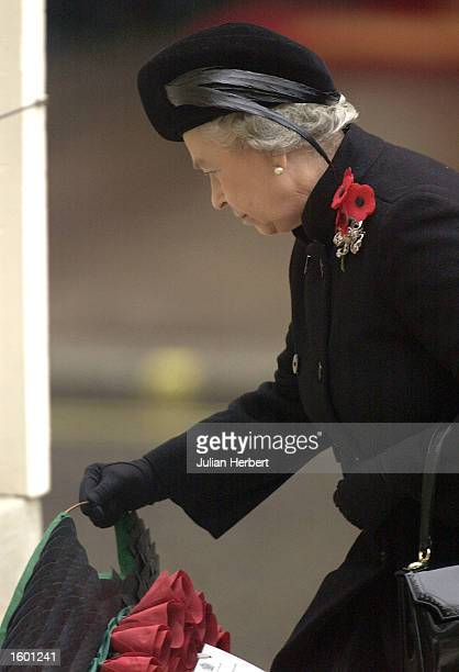 Britain's Queen Elizabeth II takes part in the annual Remembrance Day service and parade November 10 2002 in London The service included two minutes...