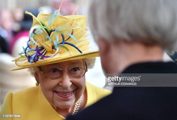 Britain's Queen Elizabeth II takes part in the Royal Maundy Service at St George's Chapel in Windsor west of London on April 18 2019 Maundy Thursday...