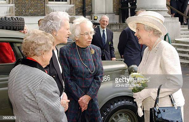 Britain's Queen Elizabeth II talks to Betty Royle from London Pat Blake from Surrey and Patsie Young from Dorset at the Imperial War Museum 14...
