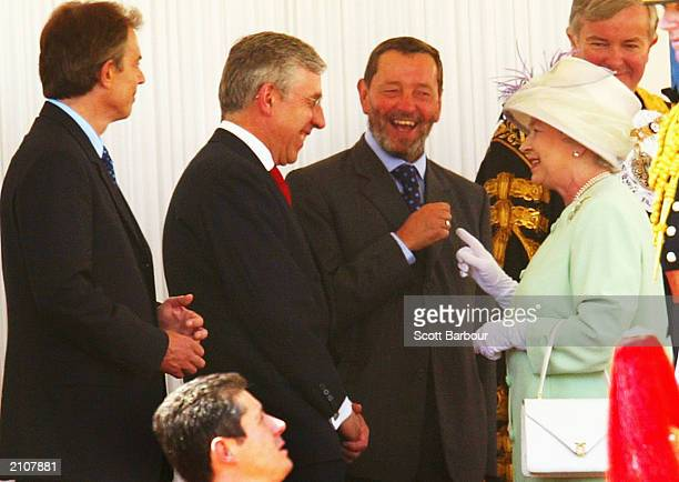 Britain's Queen Elizabeth II talks to Britain's Prime Minister Tony Blair , Foreign Secretary Jack Straw and Home Secretary David Blunkett during a...