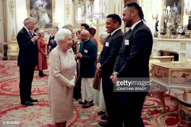 Britain's Queen Elizabeth II talks to England rugby players Mako Vunipola and Billy Vunipola during a reception for The Commonwealth Diaspora...