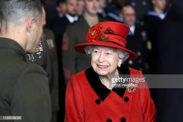 Britain's Queen Elizabeth II talks to military personnel during her visit to the aircraft carrier HMS Queen Elizabeth in Portsmouth, southern England...