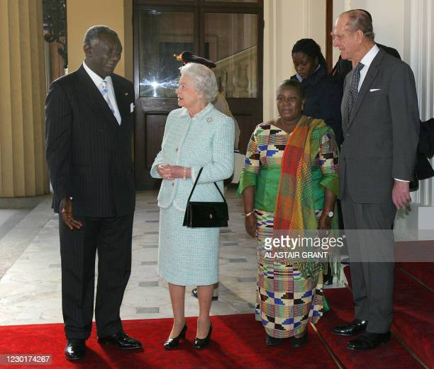Britain's Queen Elizabeth II talks to the President of Ghana John Agyekum Kufuor as he says good bye to the Queen at Buckingham Palace in London, 15...