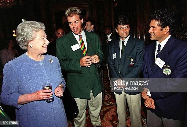 Britain's Queen Elizabeth II talks to Zimbabwe's Heath Streak Pakistan's Moim Khan and India's Sachin Tendulkar during a reception at London's...