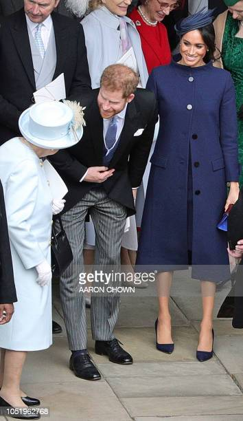 Britain's Queen Elizabeth II talks with Britain's Prince Harry Duke of Sussex and Meghan Duchess of Sussex after the wedding of Britain's Princess...
