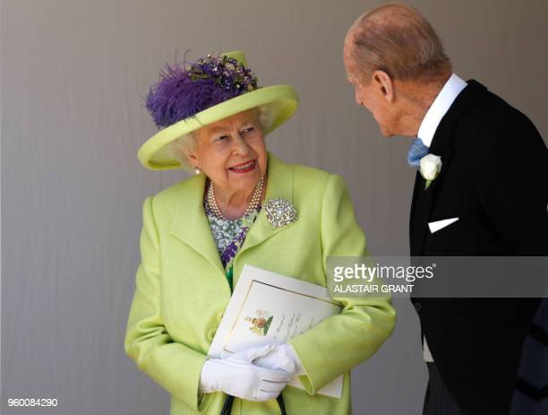 Britain's Queen Elizabeth II talks with Britain's Prince Philip Duke of Edinburgh as they leave after attending the wedding ceremony of Britain's...