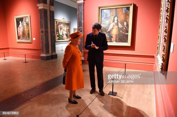 Britain's Queen Elizabeth II talks with curator Per Rumberg during her visit to the Royal Academy of Arts in London on March 20 2018 The Royal...