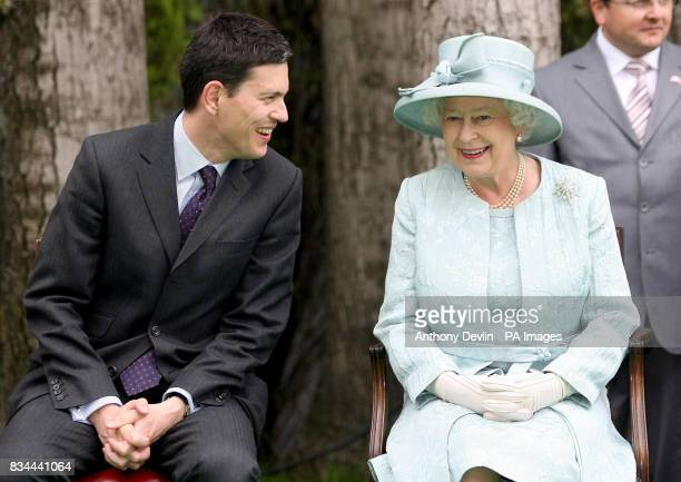 Britain's Queen Elizabeth II talks with Foreign Secretary David Miliband during the Royal garden party at the British Embassy in Ankara on the final...