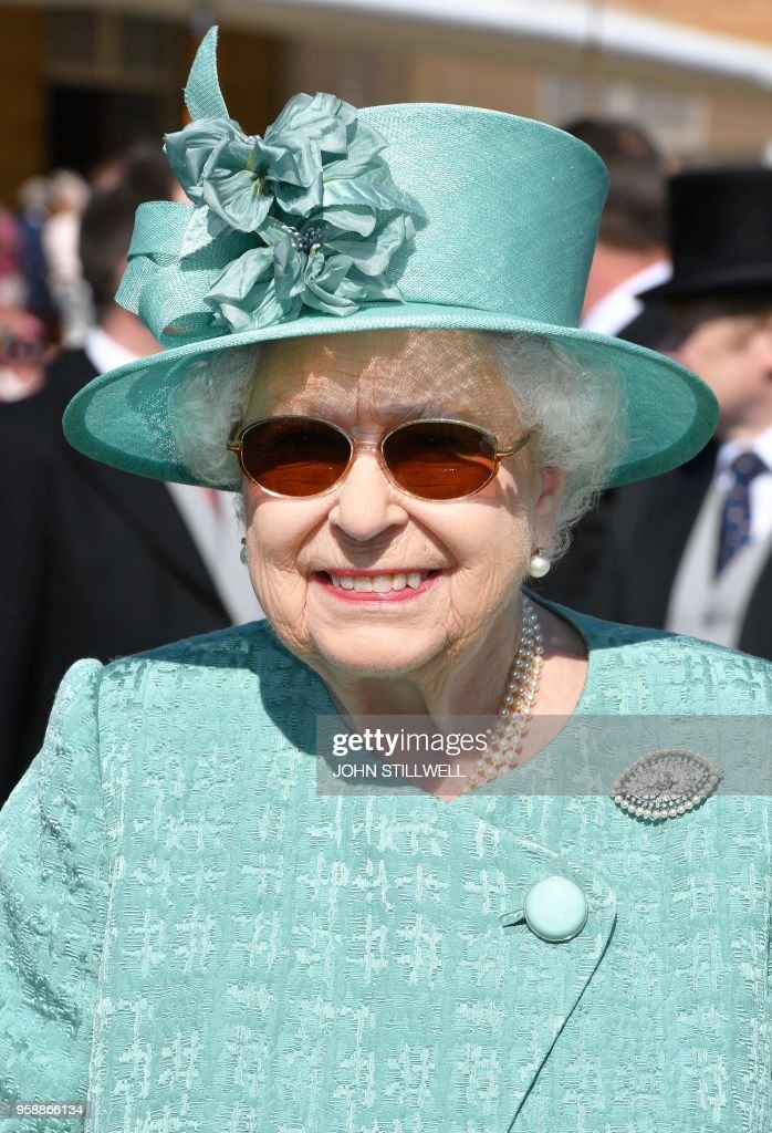 Britain's Queen Elizabeth II talks with guests during a Garden Party at Buckingham Palace in London on May 15, 2018.