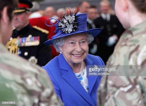 Britain's Queen Elizabeth II talks with guests during a visit to the Honourable Artillery Company in London on June 1 2016 The engagement marks the...