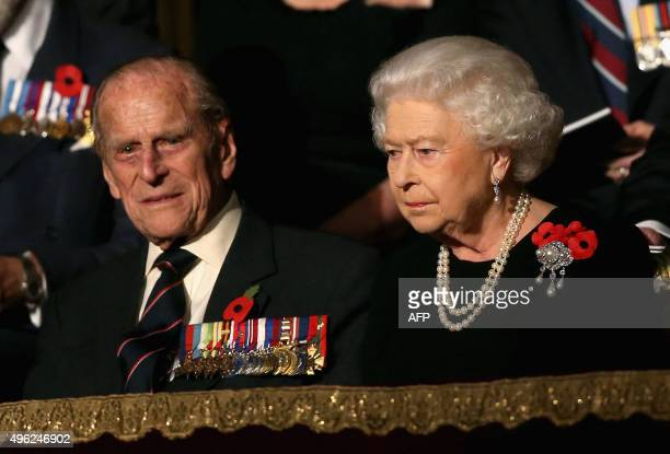 Britain's Queen Elizabeth II talks with her husband Britain's Prince Philip Duke of Edinburgh in the Royal Box at the Royal Albert Hall during the...