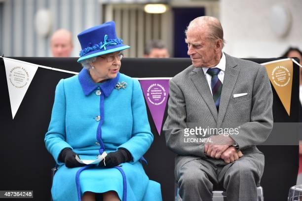 Britain's Queen Elizabeth II talks with Prince Philip, Duke of Edinburgh at Tweedbank Station in Tweedbank on the Scottish Borders on September 9,...