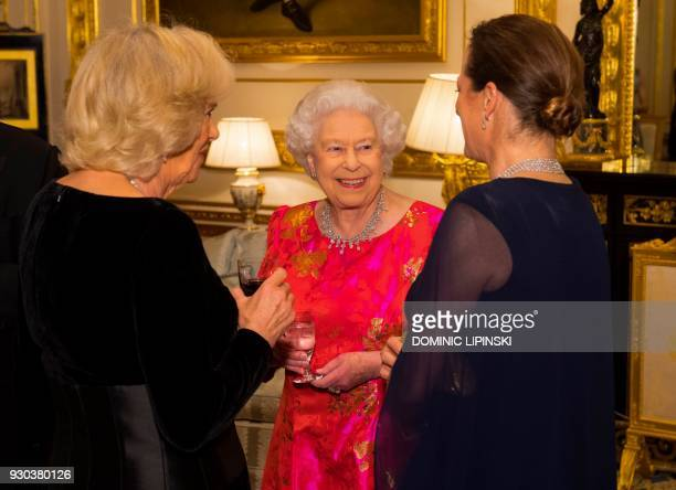 Britain's Queen Elizabeth II talks with Princess Zahra Aga Khan and Britain's Camilla Duchess of Cornwall at Windsor Castle on March 8 2018 during a...